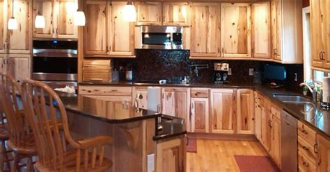 custom wood cabinets for fort collins loveland timnath rustic hickory with dual wall ovens mbs interiors