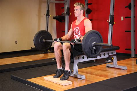 seated calf raise home barbell seated calf raise exercise guide and