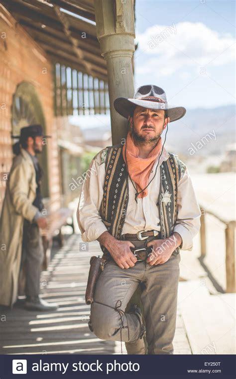 film cowboy in italiano portrait of cowboy leaning against pillar on wild west