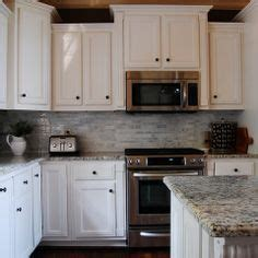range with cabinet above microwave above stove with raised cabinet above kitchens