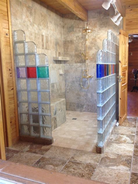 glass block shower in a rustic log home collins