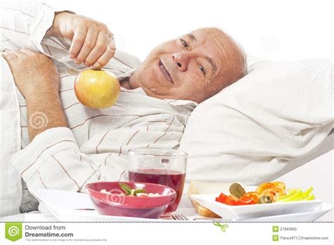 eating in bed elderly man in hospital bed eating stock image image