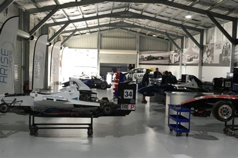 build a car workshop barbargallos race car workshop epoxy flooring perth