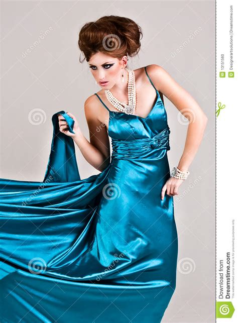 who is the woman wearing a blue dress in the viagra commercial attractive young woman wearing a blue satin dress stock