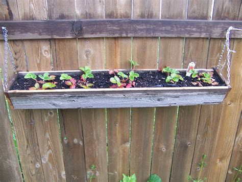 Planters On Fence by Diy Hanging Reclaimed Wood Planter Boxes Using Recycled