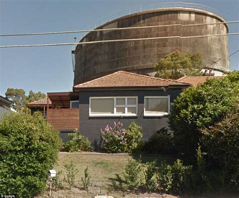sydney real estate agengy photoshops out water tower from