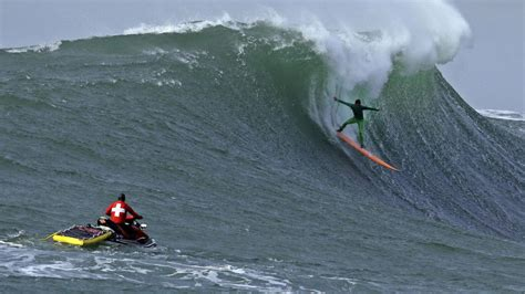 surfing competition big wave surfers paddle out for mavericks opening day ceremony in half moon bay