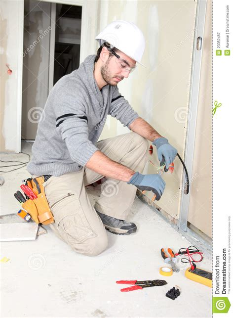 wireing a house electrician wiring a house royalty free stock photography image 23352467