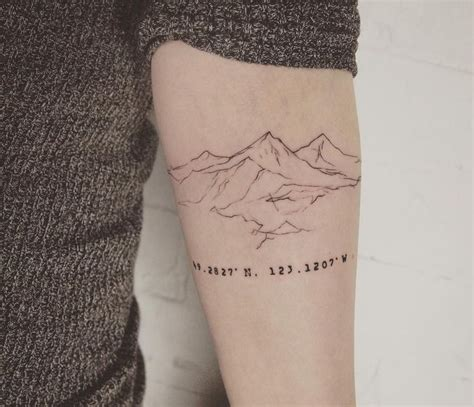 outline mountain with coordinates tattoo on arm sleeves