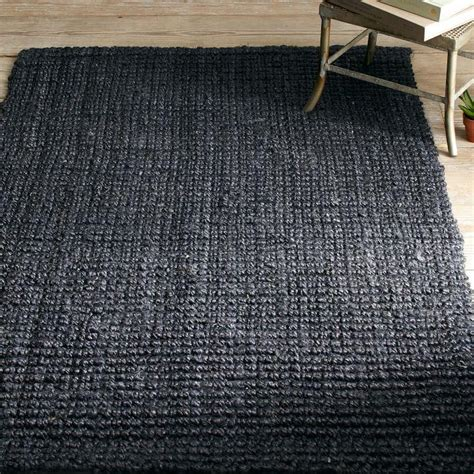 Round Jute Rugs Create Drama With Black Carpets And Rugs