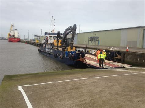 excavator sinking boat first excavator delivered by sea to the tetney sealine