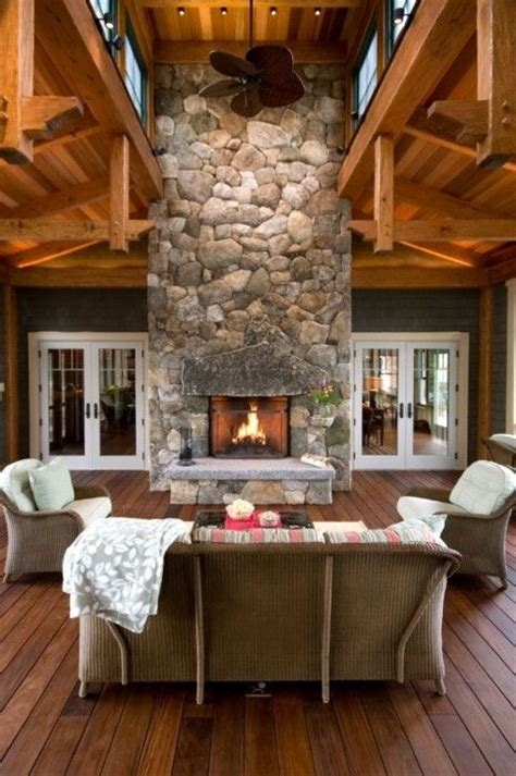 Fireplace Focal Point by A Covered Deck With Large River Fireplace As A Focal