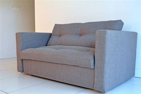 snug upholstered futon sofa bed
