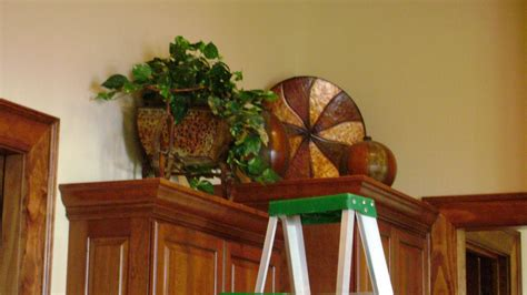 plants above kitchen cabinets how to decorate kitchen cabinets