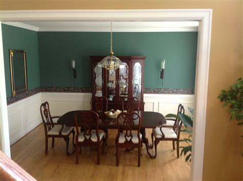 wallpaper dining room chair rail traditional dining room with wall sconce chandelier in