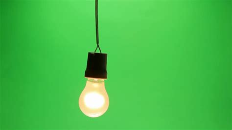 swinging light light bulb swinging in dirty dark room stock footage video