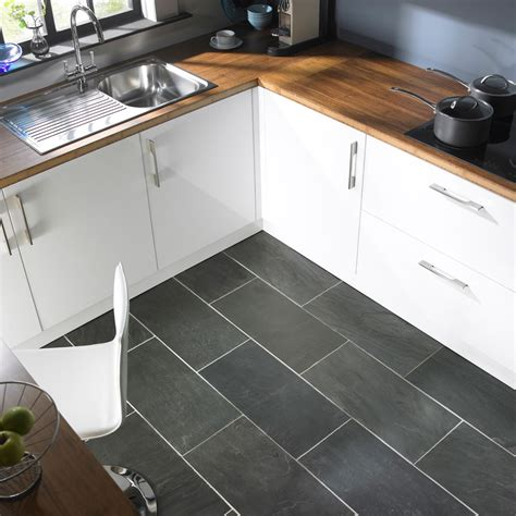 White modern kitchen table, black slate kitchen floor