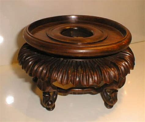price item value of antique carved wood vase stand