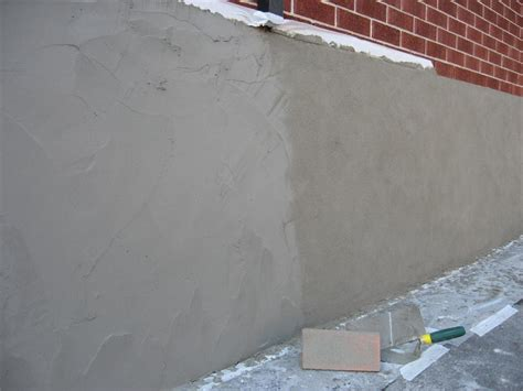 concrete basement walls parging applying a mortar coat with a trowel to leakage in masonry walls usually