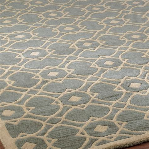 shape rug interlocking geometric shape rug available in 2 colors slate blue an