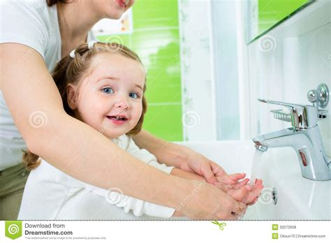 mom and me in bathroom mother washing kid hands royalty free stock photos image