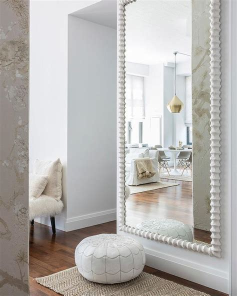 living room wall mirror white moroccan leather pouf with herringbone jute rug
