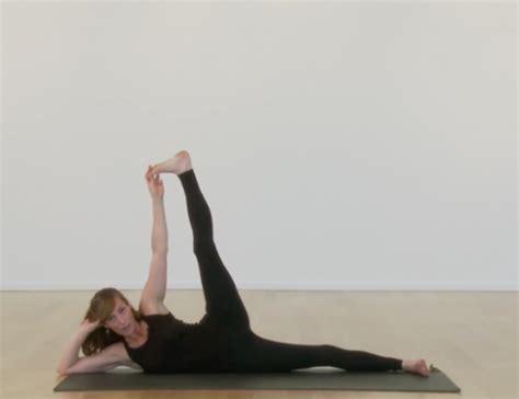side reclining leg lift yogaglo pose of the week yogaglo blog