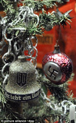 hitler  invaded christmas exhibition displays swastika baubles  porcelain heads
