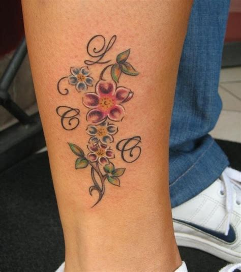 tattoos blumen arm x arm tattoo schwarz bis dunkel blau