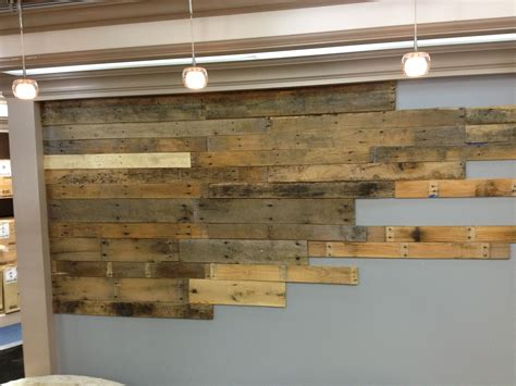 pallet wood wall with planks run through a planer prior to installing rustic pallet