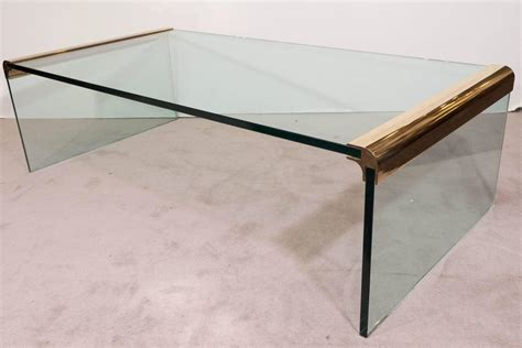 pace collection glass waterfall coffee table with brass