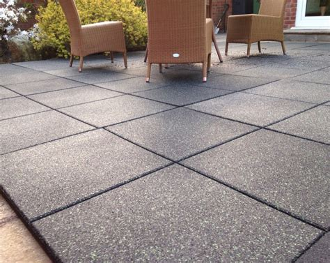transitional patio design with recycled rubber patio pavers and charcoal grey floor tiles