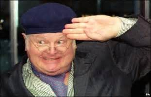 Benny hill as his most famous character fred scuttle doing the the