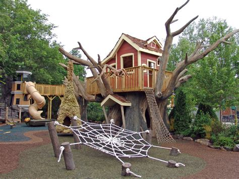 elevated tree house and lighthouse playground by themed