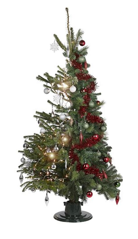 b q unveils first 50 50 fake and fir christmas tree