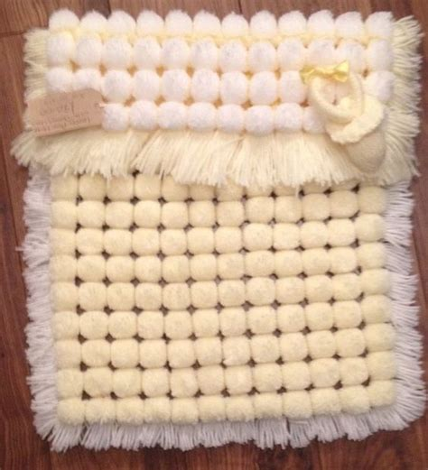 how to knit pom pom blanket pom pom pram blanket looms pram blankets