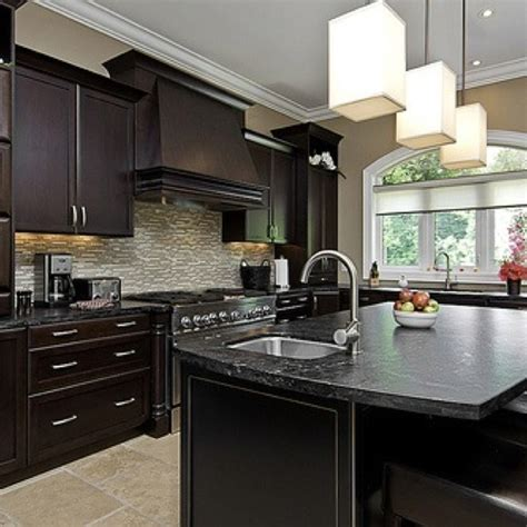 kitchen floor ideas with dark cabinets dark cabinets with light tile floor kitchen dining
