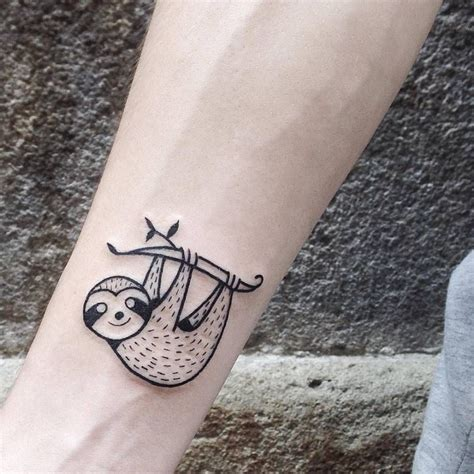 illustrative tattoo illustrative sloth on the right inner forearm