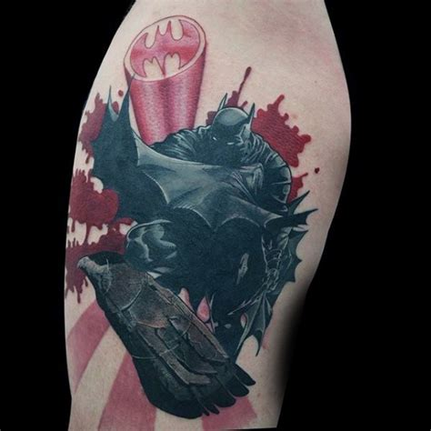 batman tattoo on back of shoulder with bats going over to magnificent colored batman tattoo on shoulder