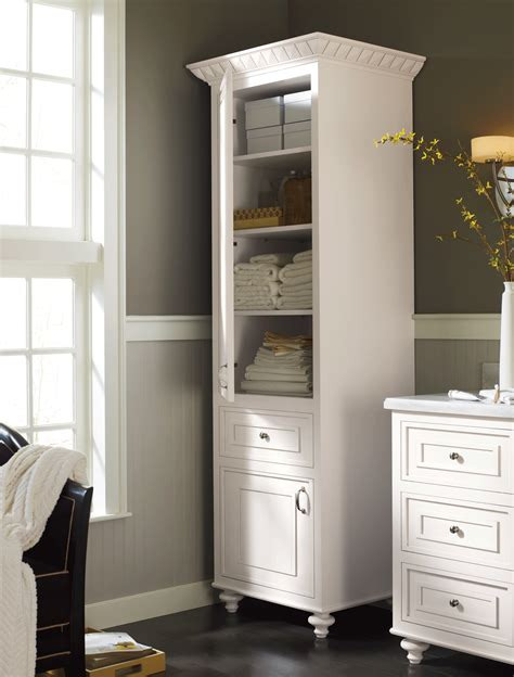 a stand alone linen cabinet adds charm and much needed