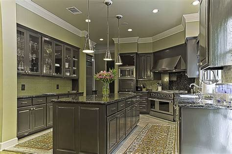 dark gray cabinets  green walls backsplash kitchen