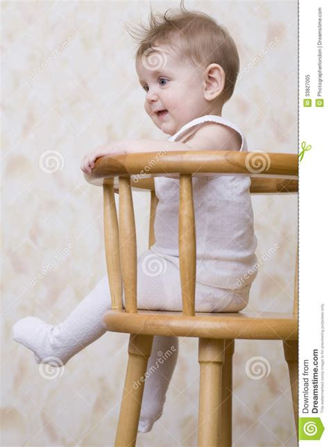 Baby On Chair by Playful Baby Boy Sitting On High Chair Royalty Free Stock