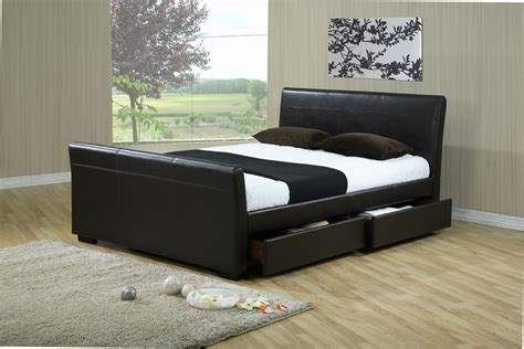 dark grey wooden bed with white leather headboard next to white faux leather double bed headboard manhattan tv bed