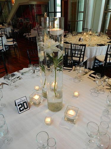 Vase And Candle Centerpieces by Gorgeous Cylinder Vase With Floating Candle Makes A