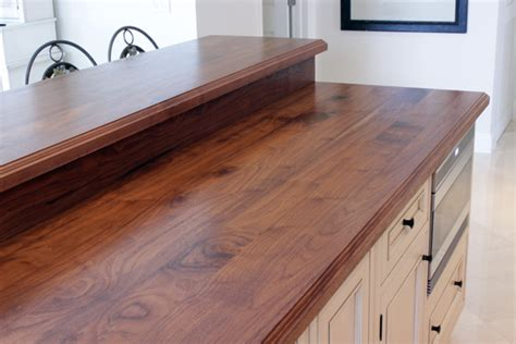 walnut counter with raised bar top and backsplash http