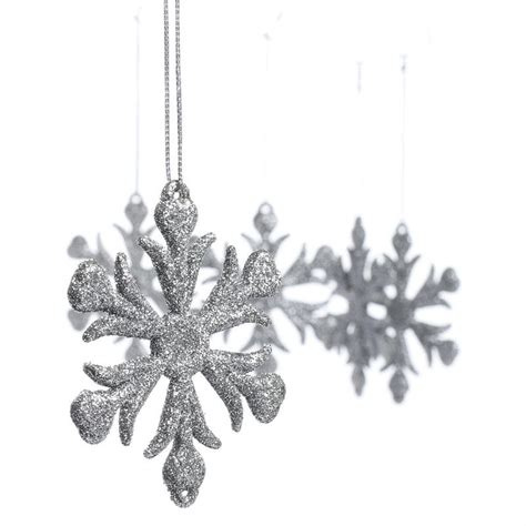 silver glittered snowflake ornaments snow snowflakes