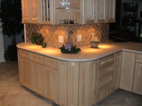 corian linen countertop maple cabinetry and linen corian countertop