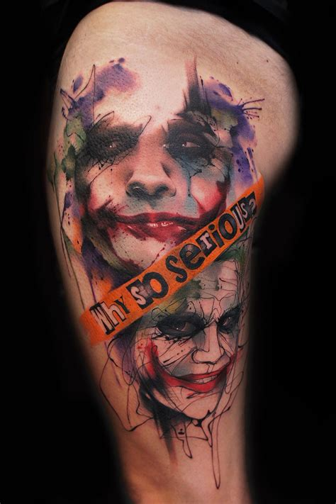 joker tattoo writing watercolor style colored thigh tattoo of joker face with