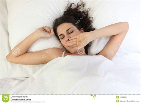 woman in bed woman waking up in bed royalty free stock photo image