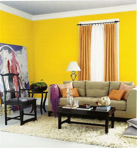 yellow paint color for modern living room interior design with grey sofa and black wood coffee